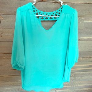 Teal blouse with open back neckline